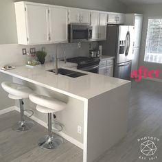 After remodel. White Quartz countertop. Waterfall countertop. Gray hardwood floor. Frigidaire gallery appliances. Kholer under mount kitchen sink. Slide in stove. White subway tile backsplash.