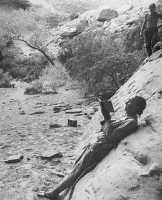 Georgia O'Keeffe reading and sketching in Glen Canyon, 1961