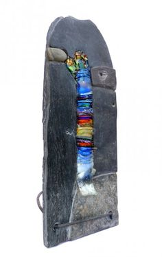 Interlude- Helen Nock Slate, stone, stained and sea glass with forged iron stand 28cm x 40cm