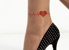 Heartbeat tattoo in red with heart