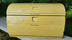 Check out this item in my Etsy shop https://www.etsy.com/listing/243594740/yellow-metal-paper-towel-wax-paper
