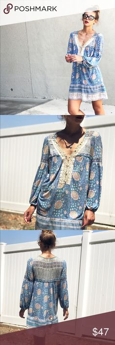 """Free People Mini Boho Dress FREE PEOPLE.Almost fairy kind of mini dress, has long sleeves with elastic band that end up a little puffed up, a beautiful V neck with pearls. Rayon and linen. Size M works great for a small as well, as I am a Small and 5'6"""". It doesn't have visible flaws but at times it seems like there are some yellowish fading here and there, when I'm just handling it, not when I'm wearing it. But anyway it's a OLD dress, so don't expect it to be flawless. Free People Dresses…"""