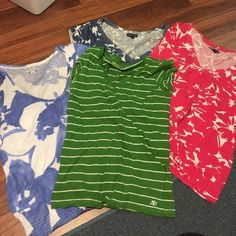 Four Shirts All are size large. All have been worn a few times but in great condition. 3 are American Eagle. Green is Aeropostale. All of my prices are negotiable. I will bundle. American Eagle Outfitters Tops