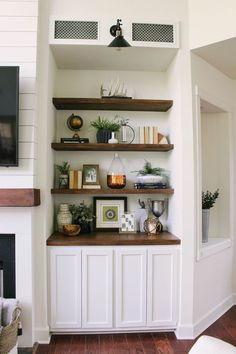 the floating shelves in our modern farmhouse fireplace and built in make. Styling the floating shelves in our modern farmhouse fireplace and built in makeover Built In Shelves Living Room, Farmhouse Shelves, Room Remodeling, Living Decor, Living Room Shelves, Home Decor, Home And Living, Farm House Living Room, Living Room Remodel