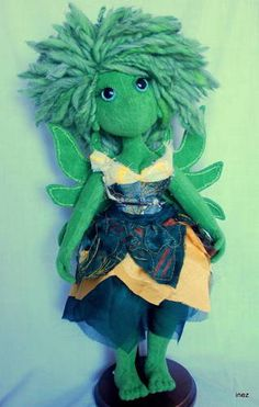 Little Green Fairy by Inez on craftster. One of my favorite poppets. I just love Inez's work.