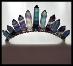 Graduated Rainbow Fluorite Points, Hand Wrapped And Attached Vertically To A 4 Inch Hair Comb With Silver Wire. The Teeth On The Comb Are Rounded, Not