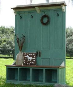 I love this! Painted a creamy soft color, with baskets in the bottom. And more hooks.