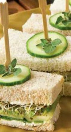 Tea party food Cucumber-Avocado Tea Sandwiches - A twist on the traditional cucumber tea sandwich, our version adds avocados, spinach, and alfalfa sprouts to the mix. Cucumber Tea Sandwiches, Finger Sandwiches, High Tea Sandwiches, English Tea Sandwiches, Cucumber Bites, High Tea Recipes, Tea Party Sandwiches Recipes, Wedding Sandwiches, Picnic Recipes