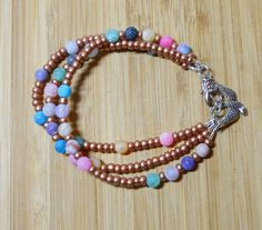 Jewelry handmade Beaded Bracelet, Copper seed beads, multi-color agates, silver clasp and barn swallow charm, Love, Beach, Sanibel Island