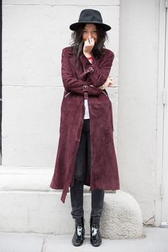 New York Closets: Aziza Azim | Man Repeller--- burgundy coat with silver zippers and buckles