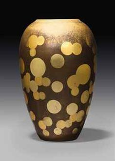 JEAN DUNAND (1877-1942)  A VASE, CIRCA 1925  lacquered metal, gold leaf decoration  9½ in. (24 cm.) high  (Sotheby's)