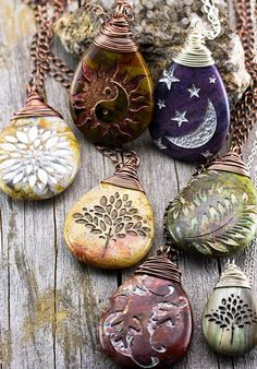 Carol Dekle-FossLast week, I was able to finish my pendants and I wanted to share how I wire-wrap them with a double bail. I like using double bails because they help prevent larger pendants from turn