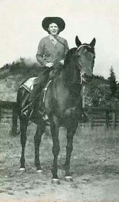 Sea Biscuit with Mrs Howard up, rare photo of Marcella was riding him. Most photos were of Mr.  Howard riding him at the farm.