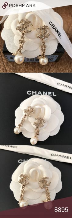 Chanel CC Logo Flower Pearl Dangle Drop Earrings Gorgeous Authentic Chanel CC Logo dangle drop earrings. Featuring gold-tone color adorned with flowers and pearls. Quiet Rare and beautiful and yet very classy. Like new condition. Come with box and jewelry pouch. Retail $1200 plus tax. CHANEL Jewelry Earrings