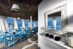 I'm looking at the floor and colors in this one. Il Riccio Restaurant Design with Blue Wooden Restaurant Furniture Picture