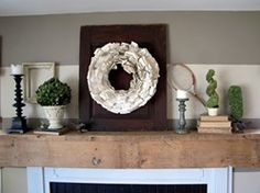 love the rustic wood mantle