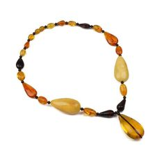 """Elegant Amber Teardrops Necklace Item No. AM03215A01 $200.89 All the colors of this necklace will highlight your skin and add charisma to your looks. The colors are: butterscotch, honey, cognac, and cherry. This necklace is made of a variety of teardrop shape highly polished amber pieces. It is 20"" long, but with center teardrop makes it 22"". It has a barrel screw twist-in clasp, which blends with the rest of amber beads."""
