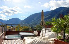 Private roof top terrace with jacuzzi and a 360° panorama view over Merano - this is Paradise Loft - artroom by Ulrich Egger