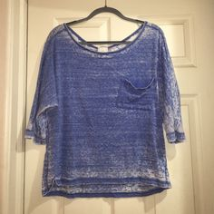 Freeloader burn out off the solder shirt Freeloader burn out off the solder shirt. Blue and white. 3/4 sleeve. Can be work as wide neck or off the shoulder. Pocket detail in front. Glory and can be worn with jeans or leggings. 38% cotton 50% polyester 12% rayon Tops Tunics