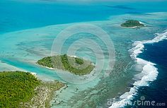 Overhead view of the atolls of Aitutaki in the Cook Islands.