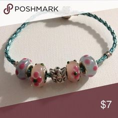 Blue and Pink Angel Charm Bracelet This adorable bracelet is made from metallic blue leather, with pink and blue glass beads, and an angel charmon it! Very similar to pandora bracelets, these charms will fit on their bracelets also! Jewelry Bracelets
