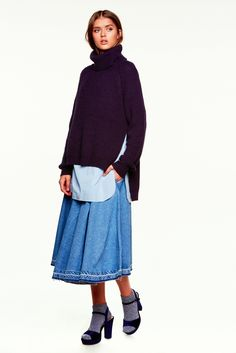 An a-line denim skirt and turtleneck sweater from the CASTRO Jeans Symphony collection