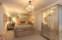 Kim Kardashian's champagne colored Old Hollywood Glam bedroom is fabulous. I want it for myself and I typically don't like antique mirrors but it works well for the space. Such a calm color palette with plush fabrics & a gorgeous tufted headboard, crystal chandelier & a ginormous armoire.