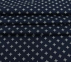 ITEM DESCRIPTION  * Fabric: Rayon.  * It is strong & light weight .  * Pattern: Floral Print .  * Color: Navy Blue.  * Transparency: Non-Transparent. * Width: 52 to 56 Inches(Approx). * Rayon is probably one of the fabrics youre likely to have in your home as clothing. Rayon is a natural fiber and is used in a wide variety of clothing and home furnishings. rayon is used in producing a wide range of items like:, napkins, shirts, summer wear, table-mats etc. Being eco friendly and 100% natu...