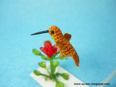 Miniature Hummingbird - Teeny Tiny Crochet Birds - Hummmingbird in Brown Blue.  via Etsy.