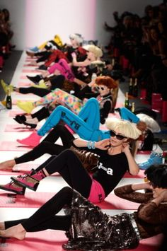 Models doing crunches at Betsey Johnson #nyfw —This is fashion that REALLY makes us happy!