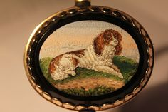 One of the finest in the artist's skill is this finely crafted micro mosaic of the ever popular King Charles Spaniel. The frame is very well designed in 14K Gold.