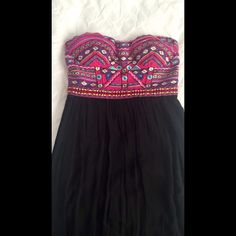 BRAND NEW Strapless Maxi This is an adorable BRAND NEW, Never worn embroidered strapless dress. It is floor length and has a zip up back. Size large. Comes from a smoke free and pet free home! Make me an offer  Dresses Maxi
