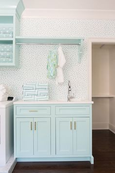 Even the laundry room gets the charm treatment, with shades of white and turquoise and plenty of storage.