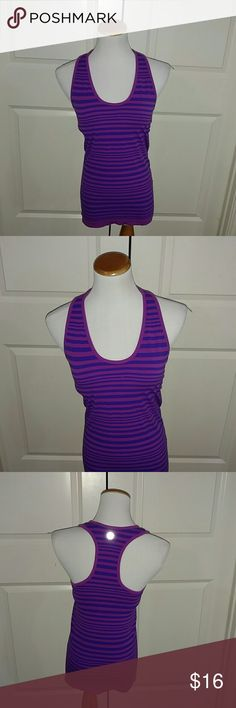 Athleta Pink Purple Stripe Workout Top This is a great Athleta pink purple Stripe workout top. Size Medium. In great condition. Athleta Tops