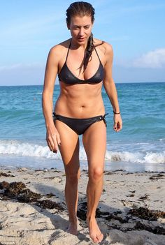 Fantastic at 45: Kate Walsh showed off her curves in a black bikini as she hit South Beach in Miami on Tuesday