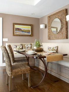 Neutral Dining Nook Neutral colors and a mix of textures give this dining nook a cozy feel. Wicker chairs contrast the sleek, smooth surface of the table. A simple corner banquette provides plentiful seating and drawers along the bottom add storage to the dining nook.