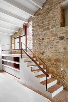 Whitewashed stone and glazed tiles feature in this renovated Spanish farmhouse