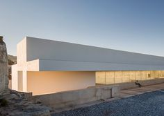 Daroca Arquitectos pairs white walls with natural stone for Baza employment centre.