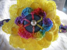 unique layered yellow fabric flower on purple by GabbyAbbyCrafts