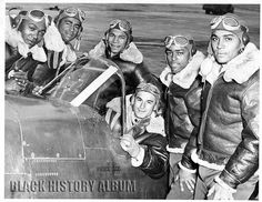 Redtails: Tuskegee Airmen Series | 1943 2/4 Six pilots from Tuskegee Airmen Class 43A posing by an airplane. All men are wearing fur-lined, leather flight jackets and wear goggles on top of their heads. One soldier appears to be seated inside the cockpit while the others surround the outside of the plane. Tuskegee, AL, 1943