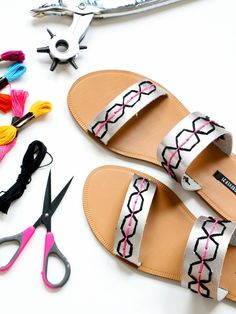 Dress up a pair of inexpensive sandals with a leather punch and embroidery floss! See how we got these custom summer shoes.