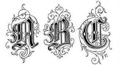 old english tattoo on fancy cursive letter b