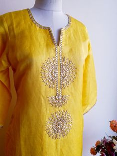 Yellow Linen Silk Kurta with Rich Gota Patti Handwork Combined here with Polka Dot Jute Silk Pants which you can Shop from the Lowers CollectionSimple yet stylish neck designs for kurtis - ArtsyCraftsyDadOrder contact my whatsapp number Embroidery On Kurtis, Hand Embroidery Dress, Kurti Embroidery Design, Embroidery Neck Designs, Embroidery Suits, Salwar Designs, Kurti Neck Designs, Dress Neck Designs, Blouse Designs