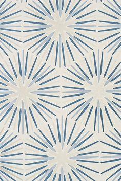 Spark Wallpaper Sunburst design wallpaper in blue taupe and cream with cracked glaze textured effect.