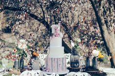 Into the wild with this stunning table decor and cake design.  As seen on The Wedding Vault. Makeup and Hair (Styled Shoot Planner) Storme Webster, Storme Makeup Designer Jessica Turner Designs Model Eve Ainsbury Venue Danesfield House Photographer Kitty Wheeler Shaw Jewellery and Hair Pieces Beverly Pile, PS With Love Florist Eram Khan, Boom Blooms Cake Kate Roche Lieberman, Dolce Lusso Cakes Stationery Holly Rees, Holly Rees London Tableware Daniela Johnston, Classic Crockery
