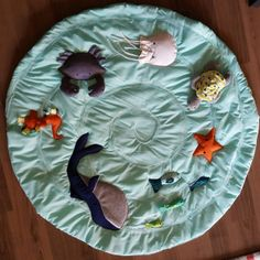 During my early pregnancy Pinteresting for baby goods I came across this adorable tummy time play matfrom Land of Nod. They were charging $119 for it, which I just couldn't justify spending…