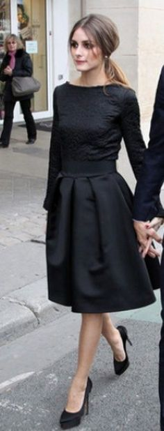 The lady in black. A demure black ballerina dress complete with long sleeves, ballerina neck and full skirt. And she manages to not be too prim or prude at all in it.