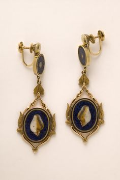 Gold earrings set with lapis lazuli plaques inset with shells and pearls in pietre dure mosaic. Naples, Italy (possibly, made), ca. 1808, length: 5.4 cm, By tradition this piece, part of a set, is believed to have belonged to Caroline Murat (1782-1839), Queen of Naples. Their accompanying leather box is stamped with a crowned 'C' in gold.