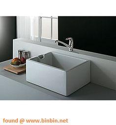 Modern belfast sink on table