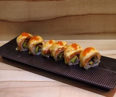 Aburi Salmon Unagi Maki glazed with Mayo Miso and Tobiko.  #aburi #maki #salmon #unagi #tobiko #mayo #handroll #sauce #shibuyasushibar #39seahstreet #japanesefood #japanese #fusion #fusionfood #torched by shibuyasushibar